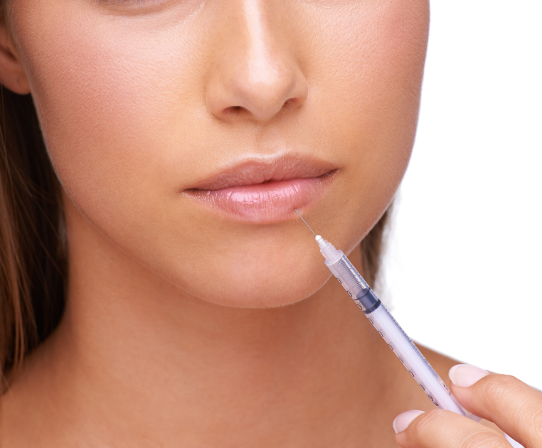 A young woman injecting her lip with botox